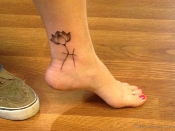 Lotus And Grey Ink Capricorn Zodiac Ankle Tattoo