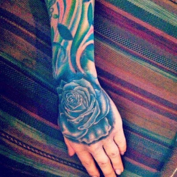 Lovely Blue Rose Hand Tattoo