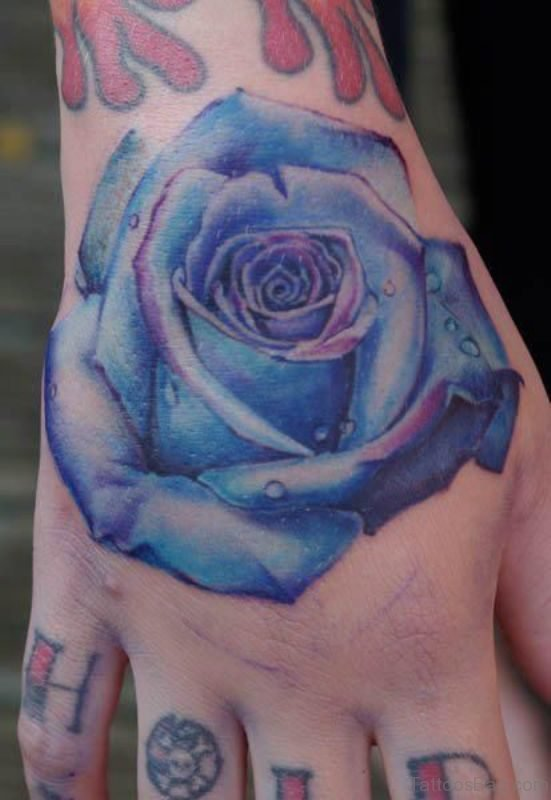 Lovely Blue Rose Tattoo On Hand