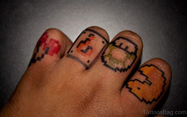 Lovely Pacman Finger Tattoo