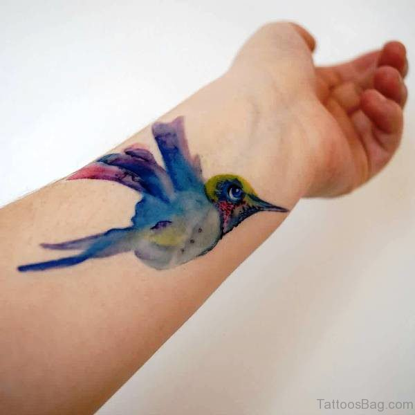 Lovely Watercolor Blue Bird Tattoo On Wrist