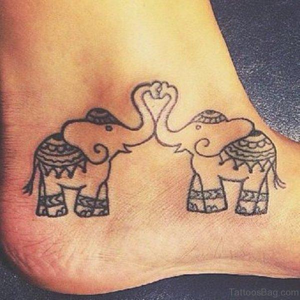 Loving Elephant Tattoo On Ankle