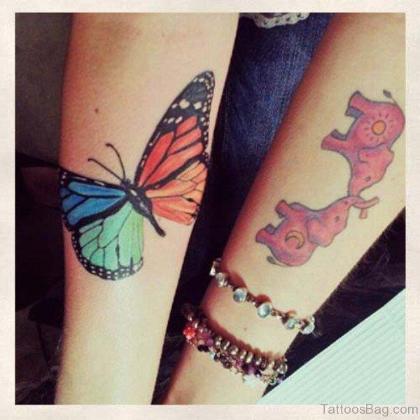 Loving Two Elephant Tattoo On Forearm