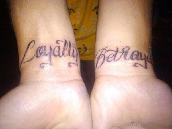 Loyalty Betrayal Tattoo On Wrist