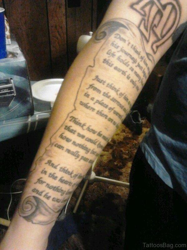Magnificent Scroll Tattoo On Arm
