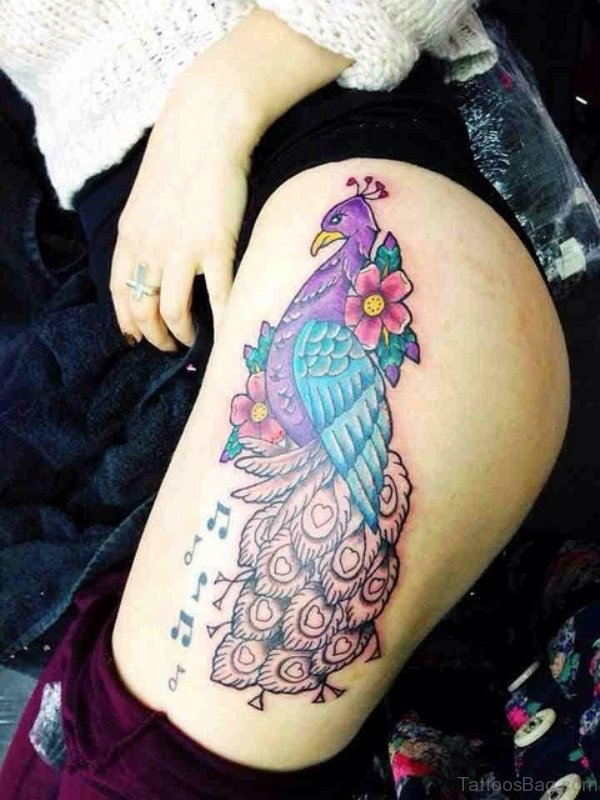 Magnifying Peacock Tattoo On Thigh