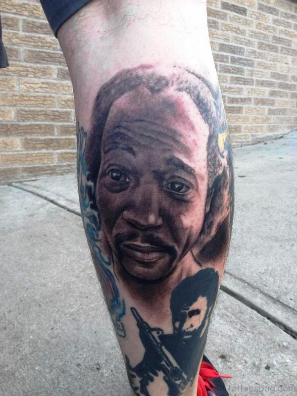 Man Face Tattoo On Calf