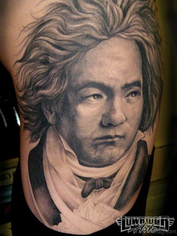 Man Rib Side Portrait Tattoo