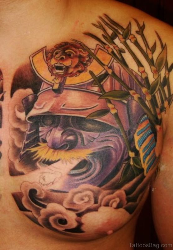Mask Tattoo On Chest