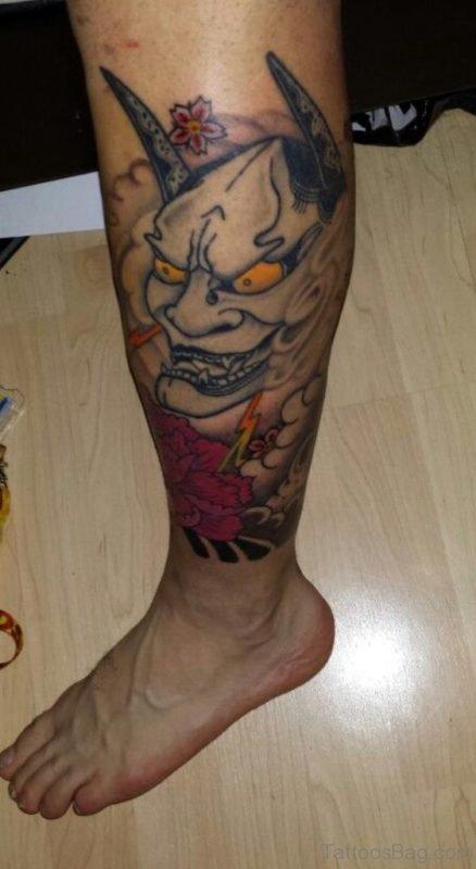 Mask Tattoo On Leg