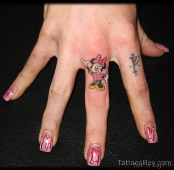 Minnie Tattoo On Middle Finger
