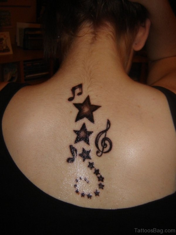 Musical Star Tattoo On Back