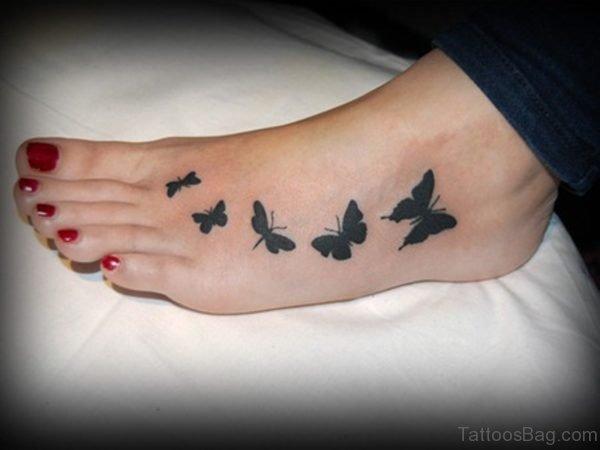 Nice Black Butterflies Tattoo