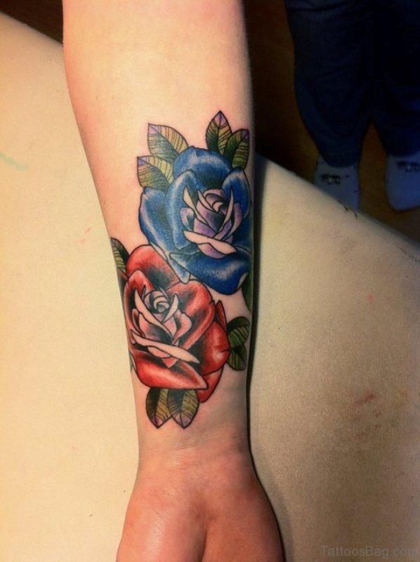 Nice Blue Rose Tattoo On Wrist