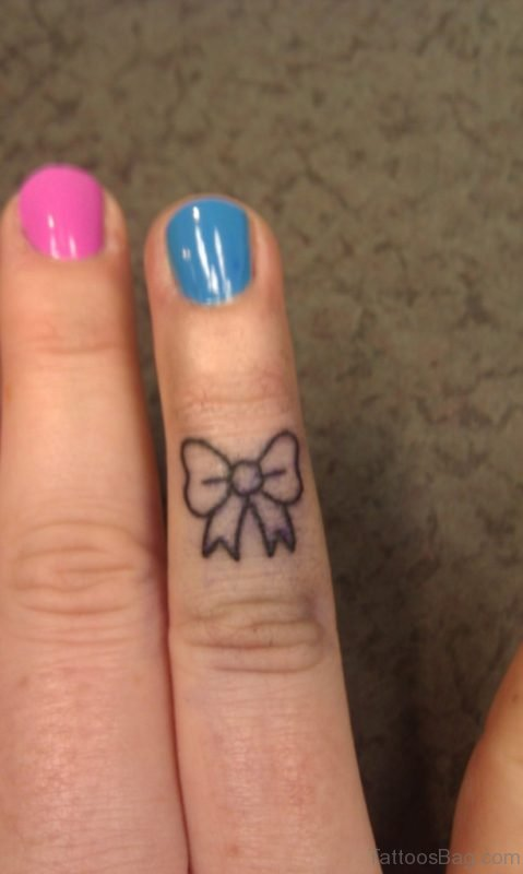 Nice Bow Tattoo On Finger