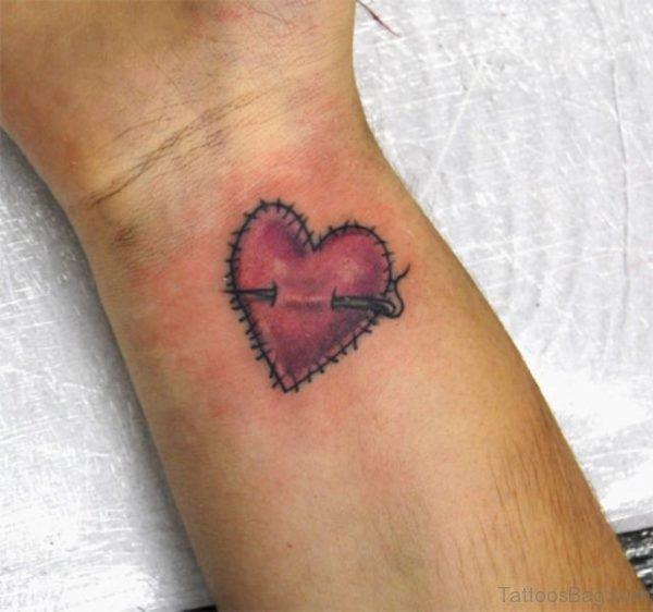 Nice Broken Heart Tattoo On Wrist