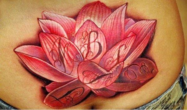 Nice Lotus Flower Tattoo Design On Lower Back
