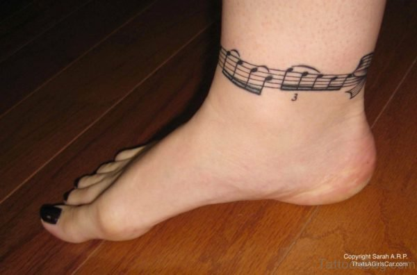 Nice Music Tattoo On Anle