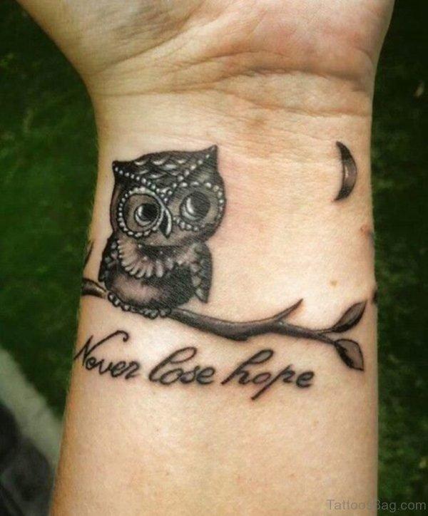Nice Owl Tattoo On Wrist