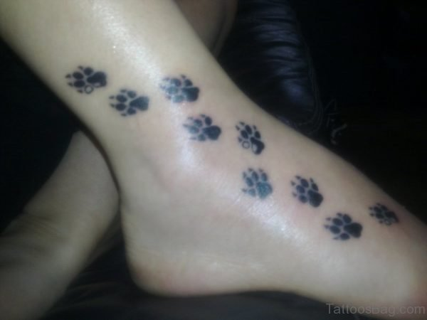Nice Paw Print Tattoo On Foot