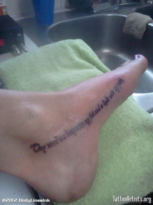 Nice Wording Tattoo On Foot