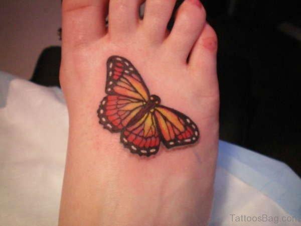 Orange Butterfly Tattoo On Foot