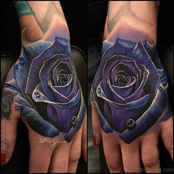 Outstanding Blue Rose Tattoo On Hand