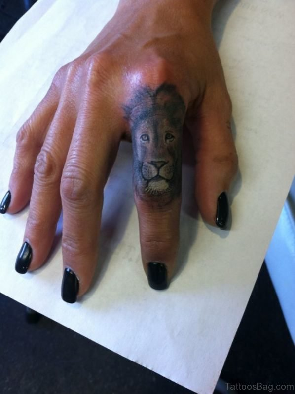 Outstanding Lion Tattoo On Finger