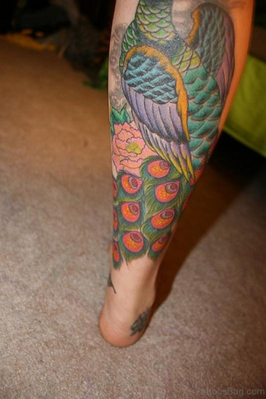 30 fantastic peacock tattoos on leg for Feather tattoo on thigh