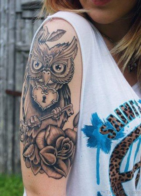 Owl Holding Key Tattoo On Right Shoulder