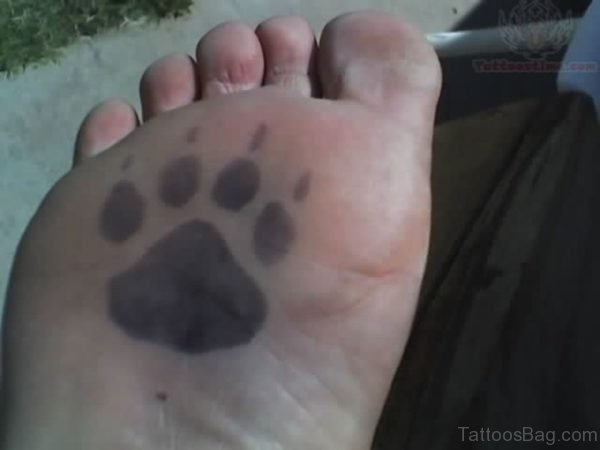 Paw Tattoo On Bottom Of Foot