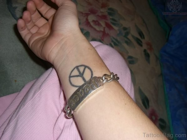Peace Tattoo On Wrist