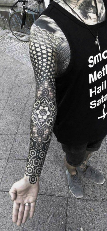 Phenomenal Black Tattoo On Arm