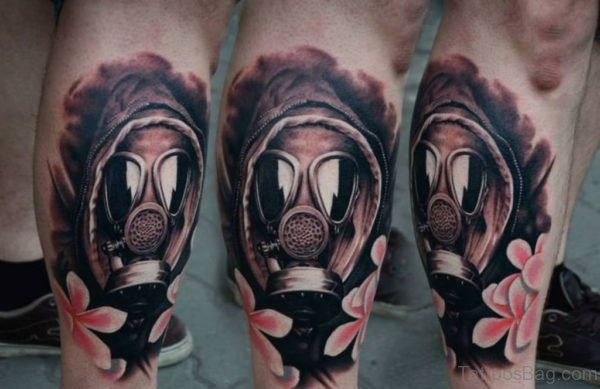 Pink Flowers And Gas Mask Tattoo On Leg
