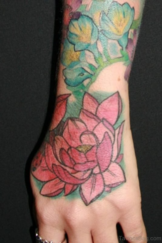 Pink Lotus And Reptile Eyes Tattoo On Hand