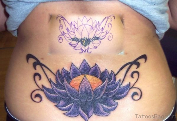 Purple Ink Lotus Flower Tattoo On Lower Back