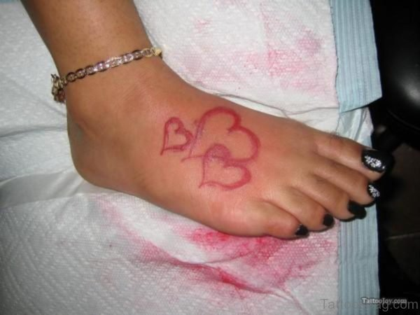 Red Heart Tattoo On Foot