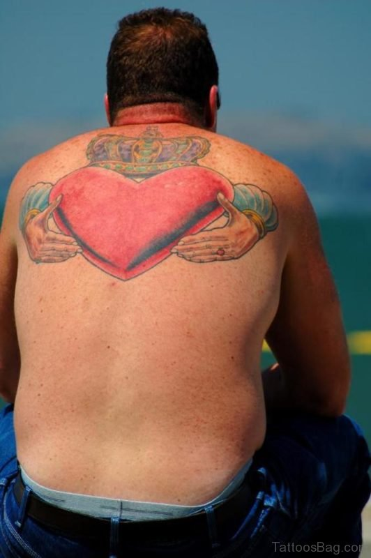 Red Heart Tattoo On Upper Back