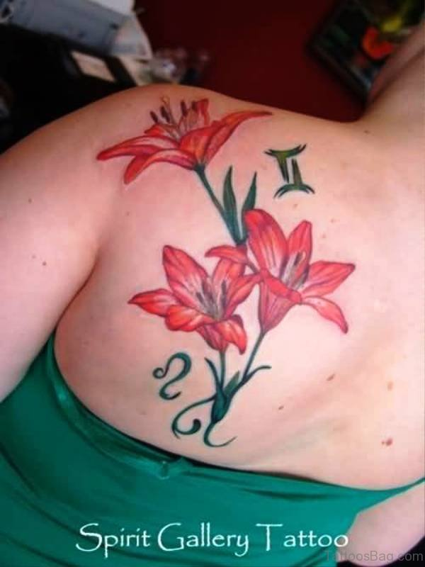 Red Ink Lily Tattoo On Back Shoulder