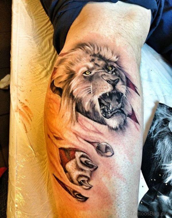Ripped Skin Lion Tattoo On Leg