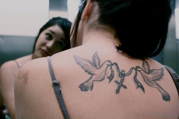 Rosary And Dove Tattoo On Upper Back