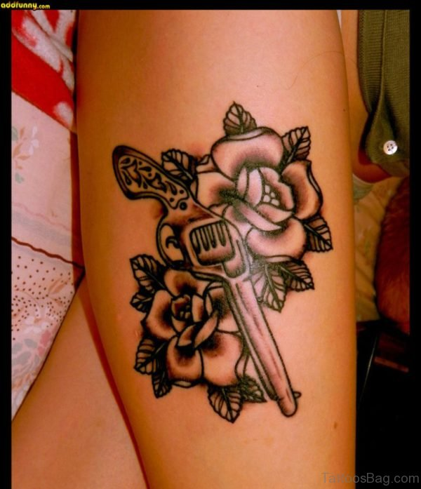 Rose And Gun Tattoo On Thigh