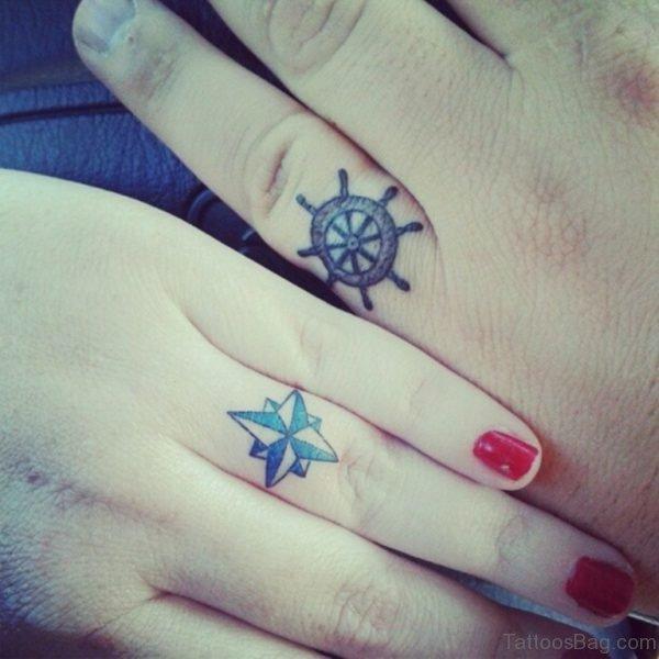Ship Wheel And Star Tattoo
