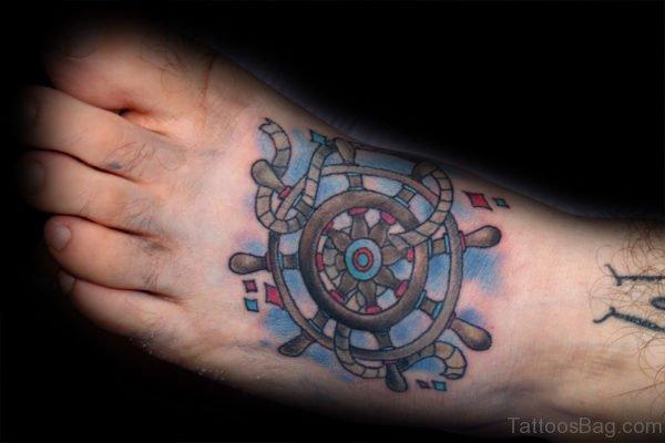 Ship Wheel Tattoo On Foot
