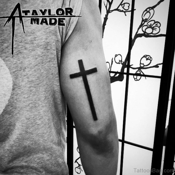 Simple Black Cross Tattoo On Arm