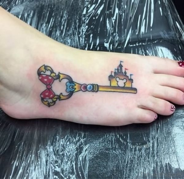 Simple Colorful Disney Key Tattoo On Girl Foot