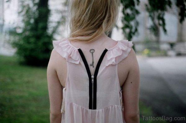 Simple Key Tattoo On Upper Back