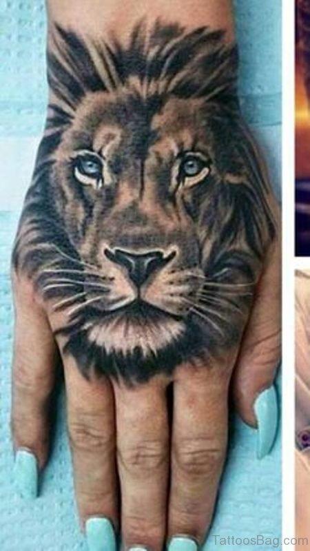 38 elegant lion tattoos on hand. Black Bedroom Furniture Sets. Home Design Ideas