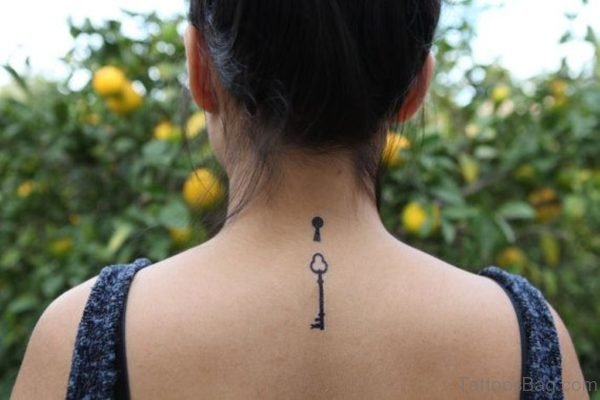 Simple Little Key With Key Hole Tattoo On Back
