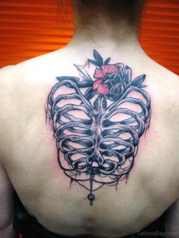 Skeleton With Flower Tattoo On Back